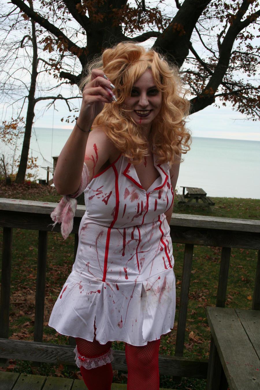 http://fc08.deviantart.net/fs51/i/2009/308/8/7/Attack_of_the_Zombie_Nurse_by_KouranKiyo.jpg