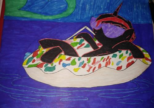 Nightspell floating on a tutti frutti donut.