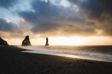 Black sand and rising sun by HendrikMandla