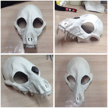 Resin canine skull (upper) primed and up for grabs by MissRaptor