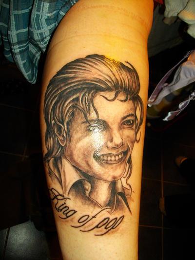 http://fc07.deviantart.net/fs50/i/2009/263/7/7/Michael_Jackson_Tattoo_by_LARvonCL.jpg