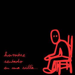 hombre sentado en una silla...