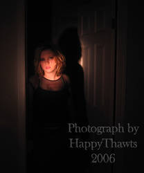 As she stands in the door