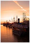 Fishing Boats at Sunset by Val-Faustino