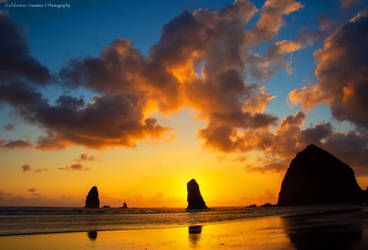 Sunset on the Rocks II by Val-Faustino