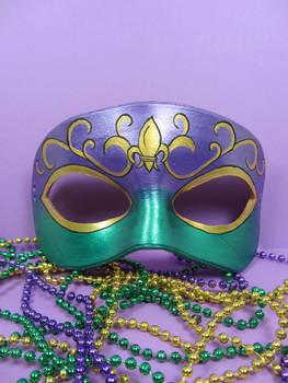 Mardi Gras masquerade mask with fleur