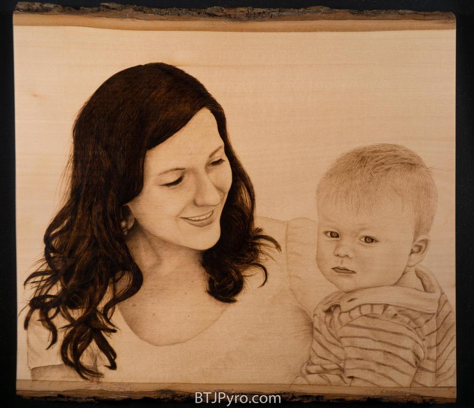 Mother and child - handcrafted woodburning by brandojones