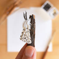 The White Ermine Moth