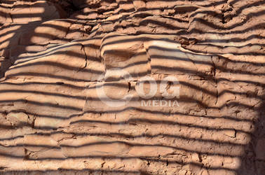 Red Rock with Horizontal Shadows by ecogmedia