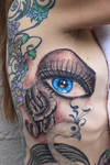 Eye and feathers tattoo
