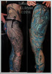 two monocromatic leg sleeve tattoos