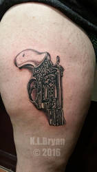 Smith and Wesson revolver tattoo by danktat