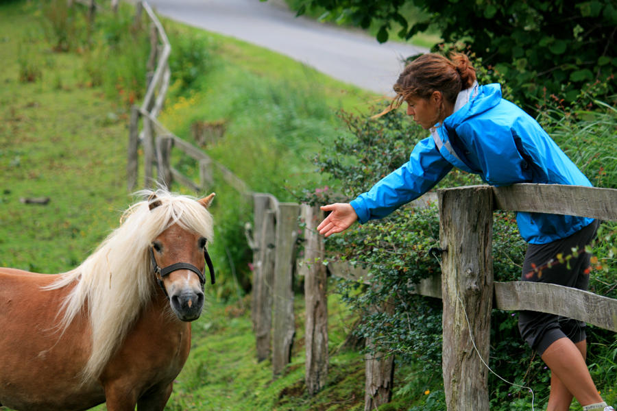 Simone greets a horse. by johannmetzger