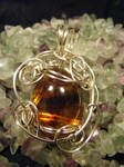 simple free form amber and silver pendant