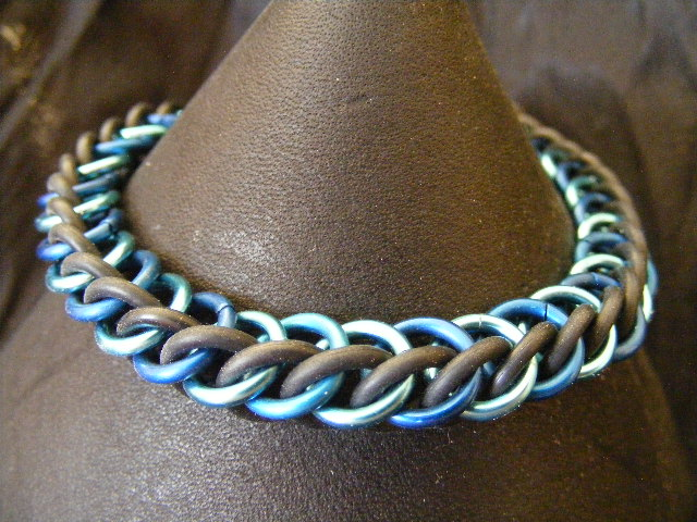 HP3-1 in shades of blue with black stretchy bracel by BacktoEarthCreations