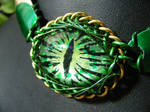 Green dragon eye with scales