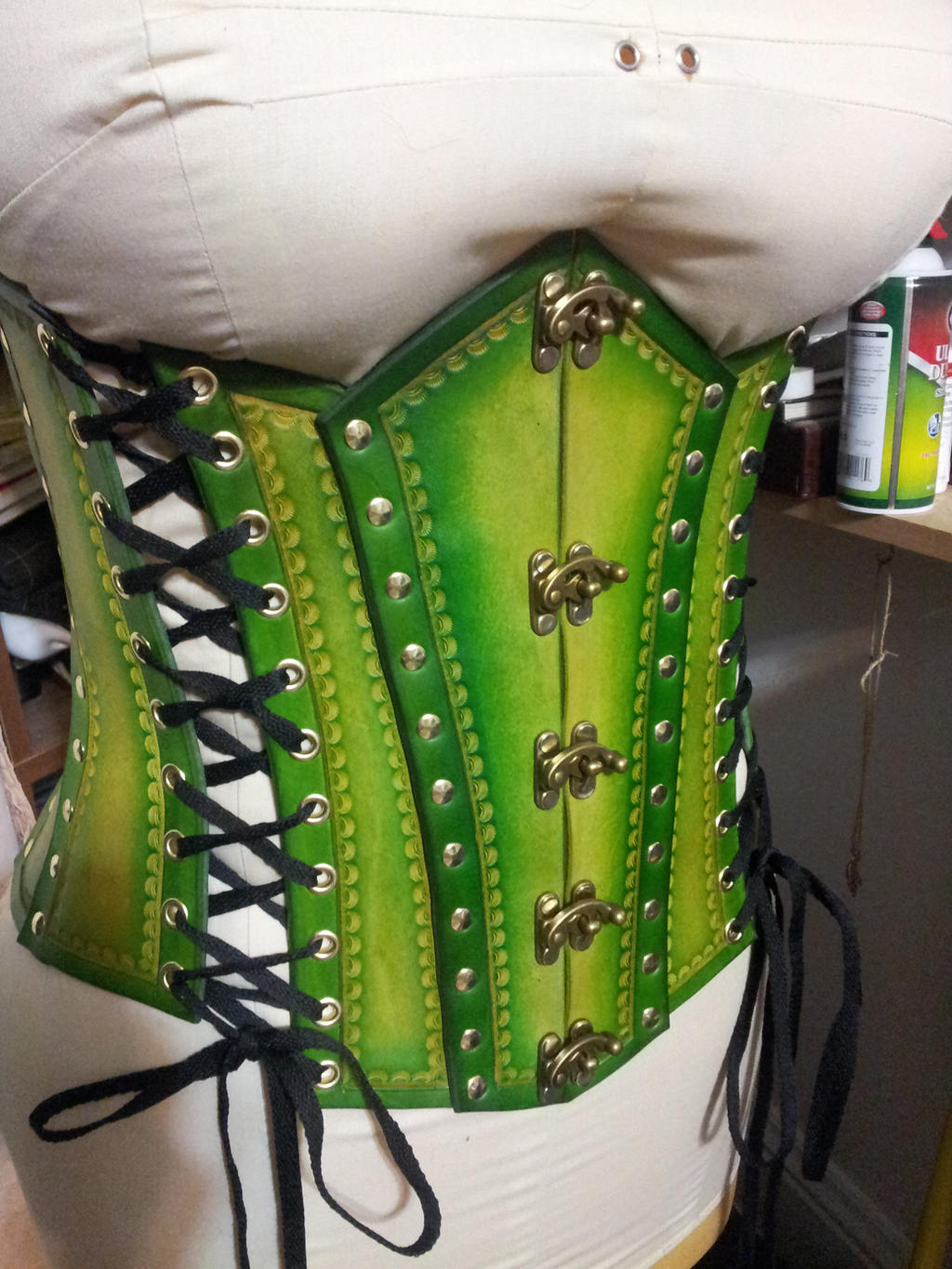 Tones of green tooled corset by BacktoEarthCreations