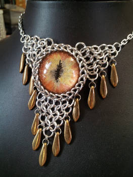 Bronzed fire eye in chainmaille with bronze dagger