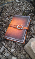 brown silver leather grimoire