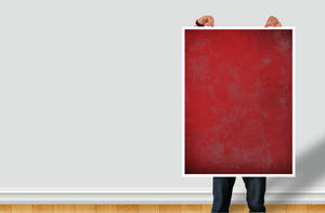 Man Holding Poster - PSD DOWNLOAD