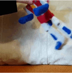 GIF of Plush Starscream transforming