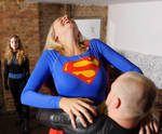 Gorgeous Supergirl is crushed in a tight bearhug