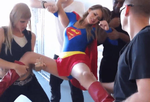 Sexy Supergirl struggles helplessly as she is held