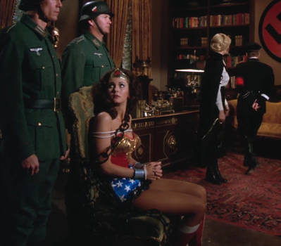 Wonder Woman chained and tied, time to interrogate
