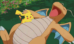 Pikachu tickles Dragonite's belly [GIF]