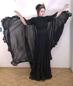 Stock - Dark sorceress hands up wind dark