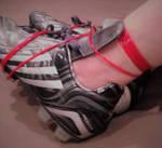 Ankles tied with clothesline in Adidas Predators. by SneakerBoyBondage