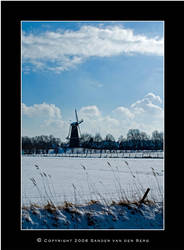 Windmill in the Snow by sandervandenberg
