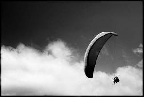 paragliding on a cloudy day by slazzy