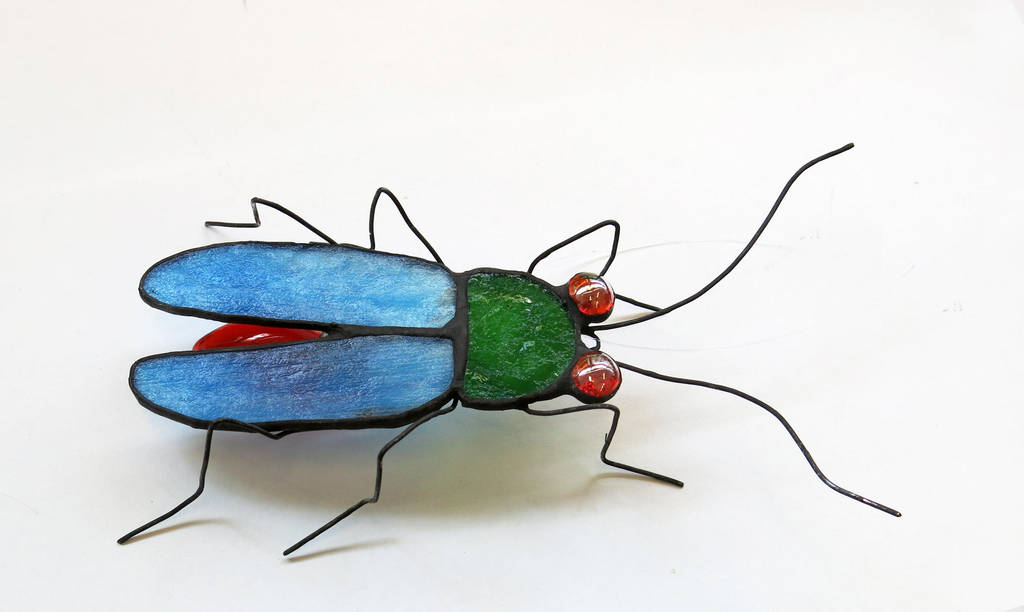 firefly lightning bug stained glass sculpture by trilobiteglassworks