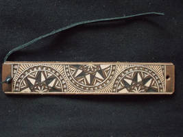 Carved leather bracelet by dionesambrozius
