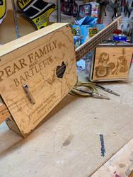 Pear Family Cigar Box guitar by DustyPony