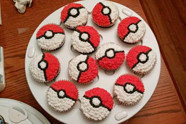 Pokeball cupcakes by darklizard14