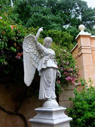 angel statue in a garden by midoriakaryu
