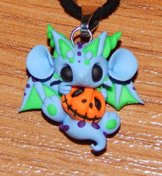Blue Dragon holding a Pumpkin by XDtheBEASTXD
