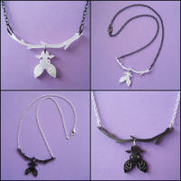 Hanging Bat Necklaces by melkatsa