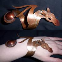 dragon bracelet by Scribblekin