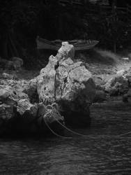 Rocks and boats by SmashingChris