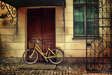 Her yellow bike by Pajunen