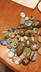 a bunch of rocks I've painted. by firemoonhalk