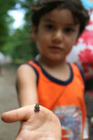 Little kid with tiny frog by Ph0Xy