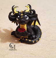 black dragon with a heart by claymeeples