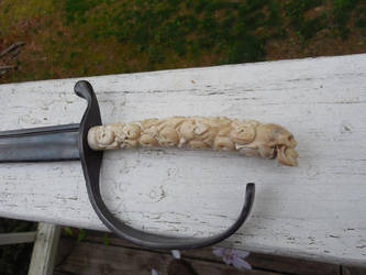 Hand Carved Skull Handled Sword by WillKing156