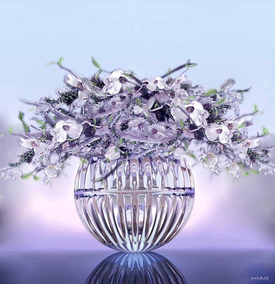 Flower arranging in glass vase by marijeberting