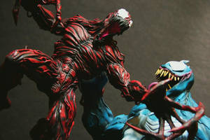 Venom vs Carnage close up by FritoFrito