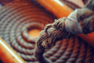 frayed rope in a coil by ChristinePhotoArt
